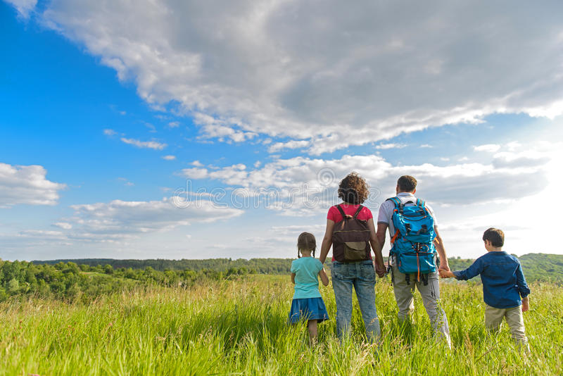 Young family hiking on mountain royalty free stock photo