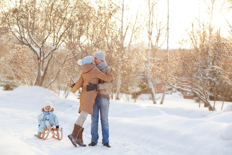 Young family hugging in the park stock image