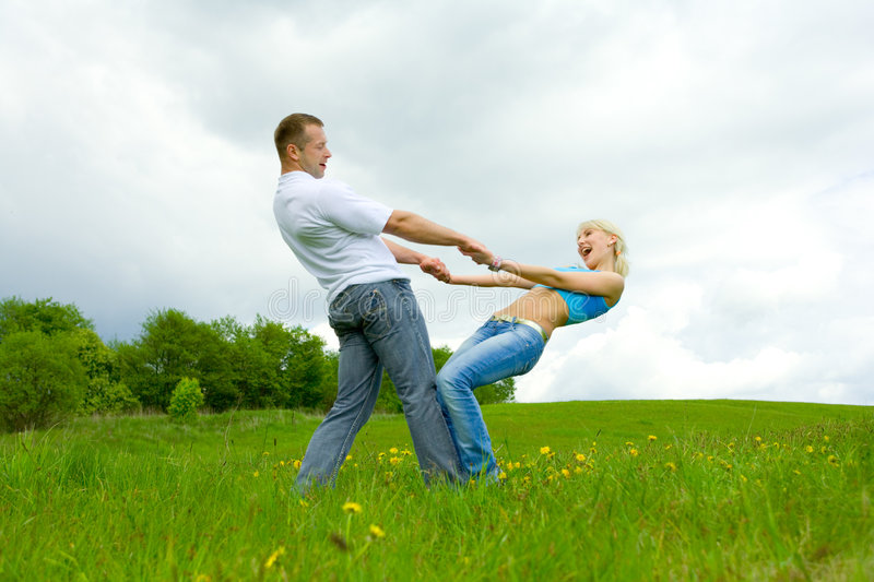 Download Young family jumping stock photo. Image of lawn, jump - 5360722