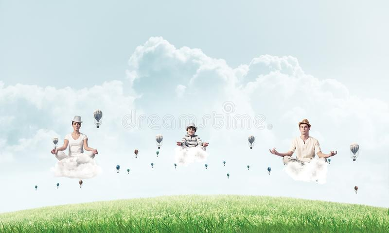 Young family keeping mind conscious. royalty free stock image