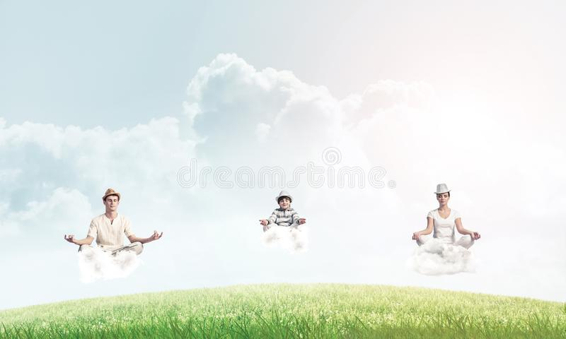 Young family keeping mind conscious. royalty free stock photos