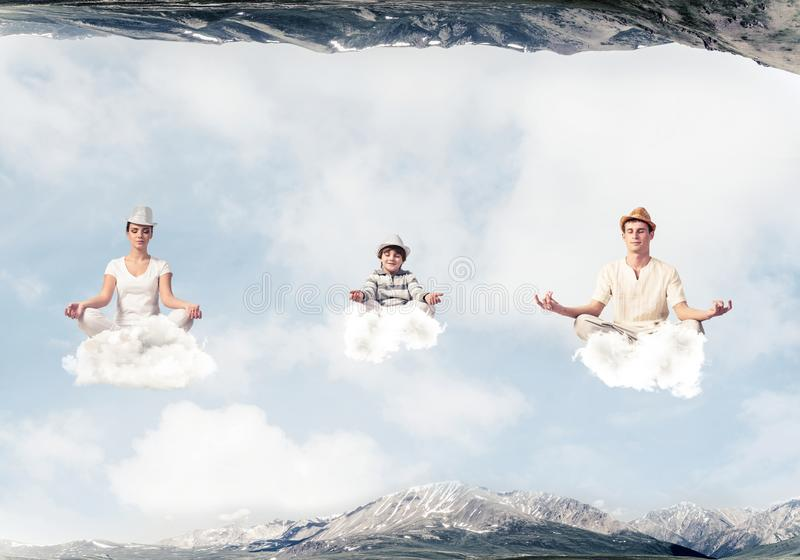 Young family keeping mind conscious. stock photo
