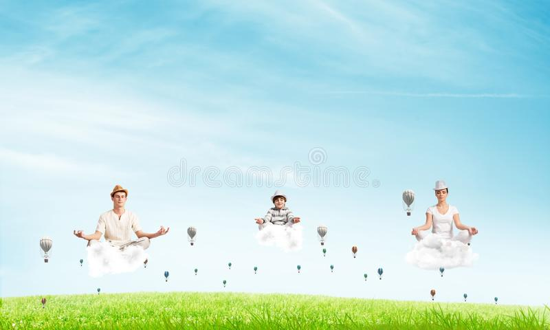 Young family keeping mind conscious. royalty free stock photography