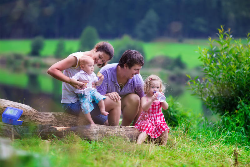 Young family with kids hiking at a lake royalty free stock image