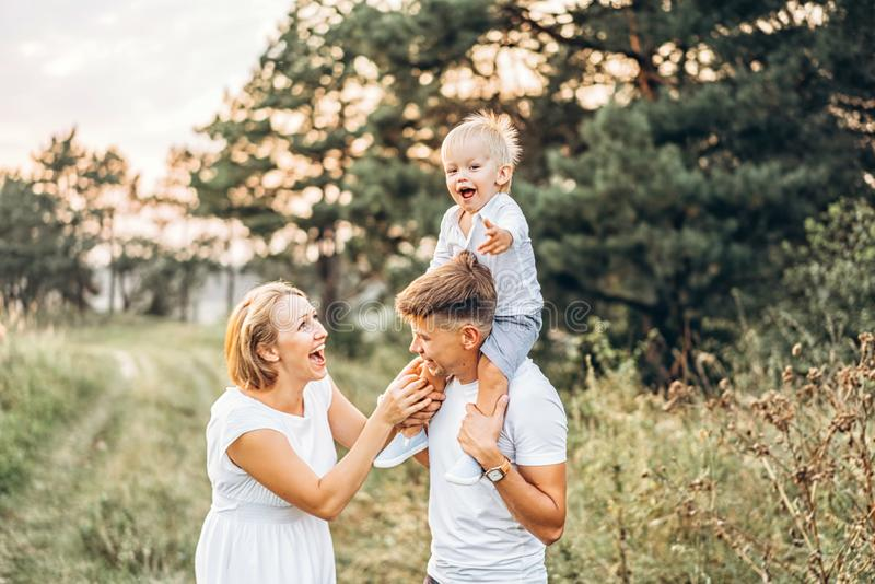 Young family with little son have fun outdoor stock photo
