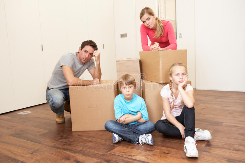 Download Young Family Looking Upset Among Boxes Stock Image - Image: 18044753