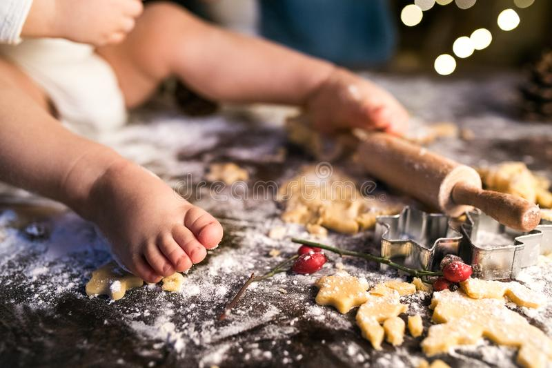 Young family making gingerbread cookies at home. stock images
