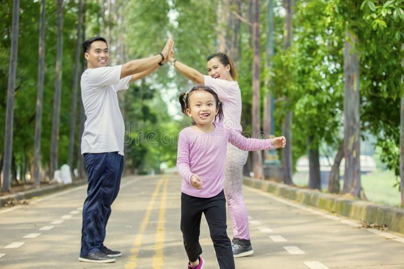 Young family making house symbol in the park stock photo