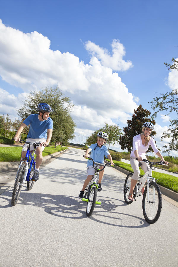 Young Family Parents And Boy Son Cycling Stock Image
