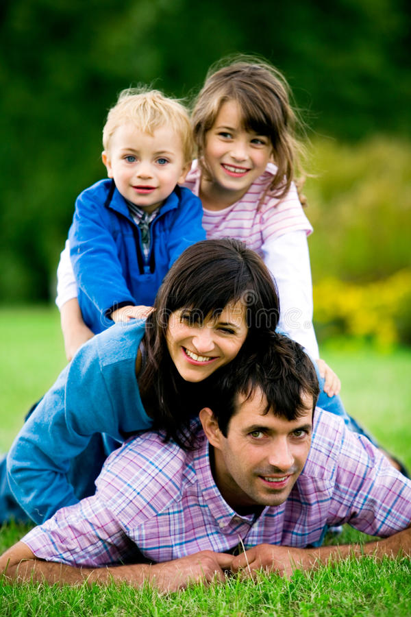 Download Young Family in Park stock image. Image of down, happy - 10857913
