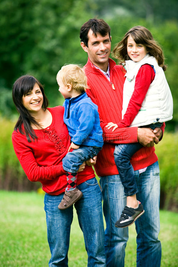 Young Family in Park stock photo