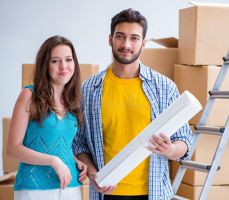 Young family planning home refurbishing in DIY concept royalty free stock image