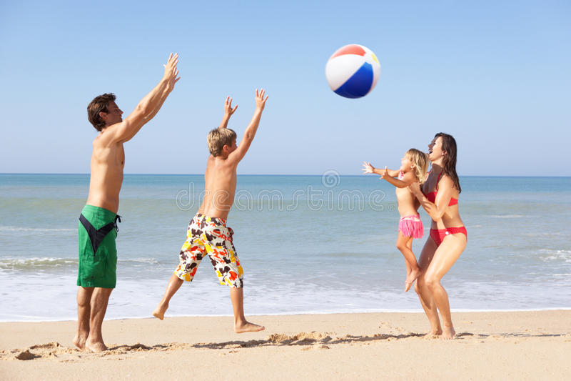Young family play on beach royalty free stock photos