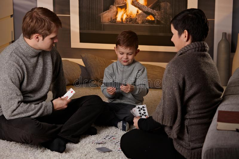 Young family playing card game royalty free stock image