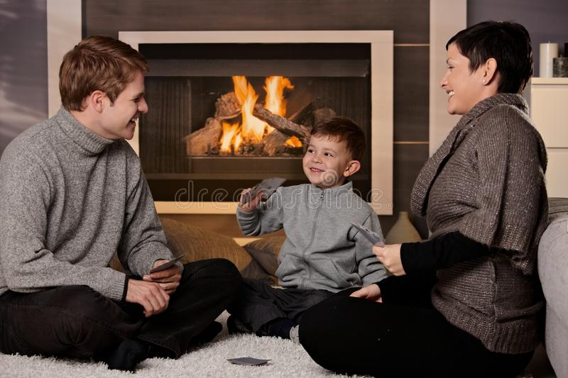 Young Family Playing Card Game Stock Images