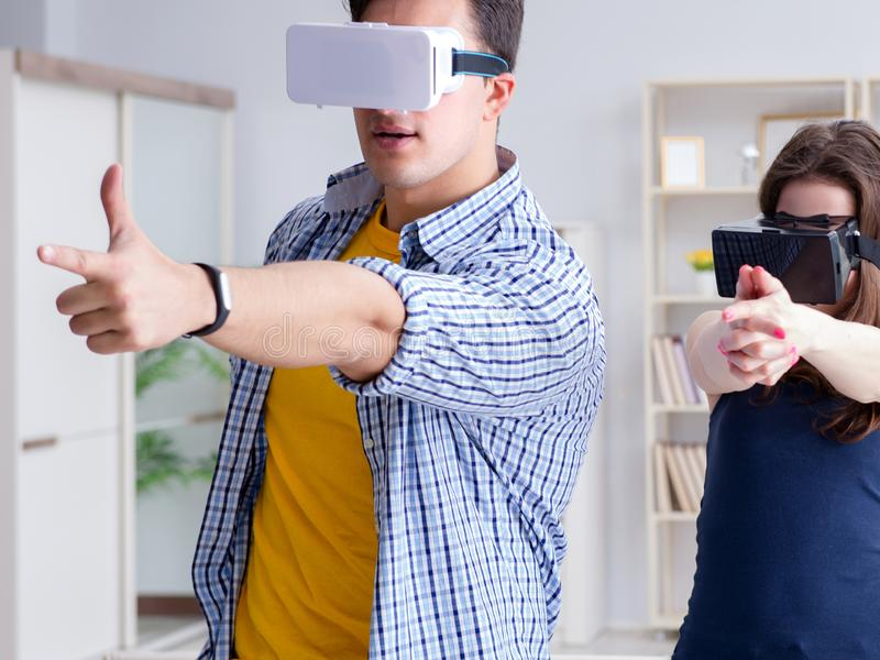 Young family playing games with virtual reality glasses. The young family playing games with virtual reality glasses stock images