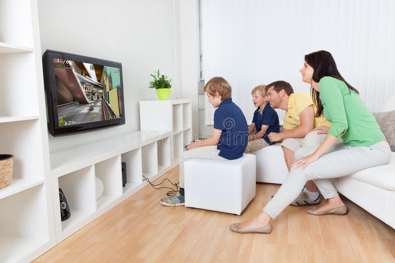 Download Young Family Playing Videogames Stock Photo - Image: 27741474