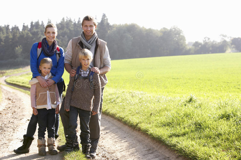 Young family posing in park royalty free stock photography