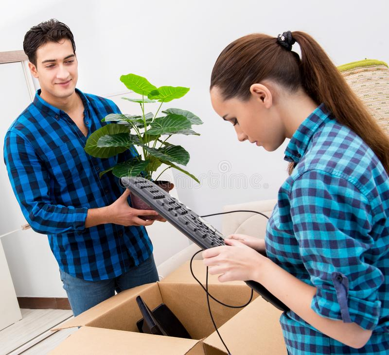 Young family relocating to new house apartment royalty free stock images
