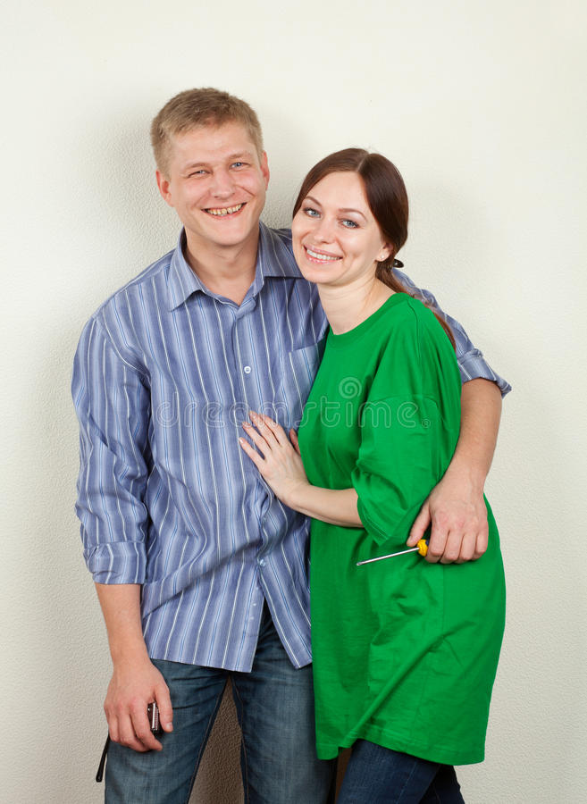 Download Young Family During The Repair Stock Photo - Image: 23468560