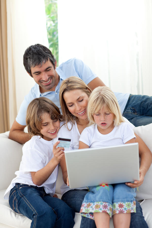 Young family shopping online. In the living-room royalty free stock photos