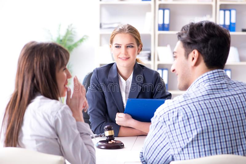 The young family signing marriage documents at laywers office royalty free stock image