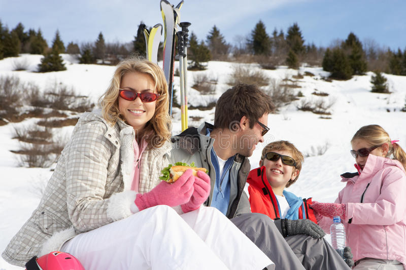 Young Family On Ski Vacation royalty free stock images