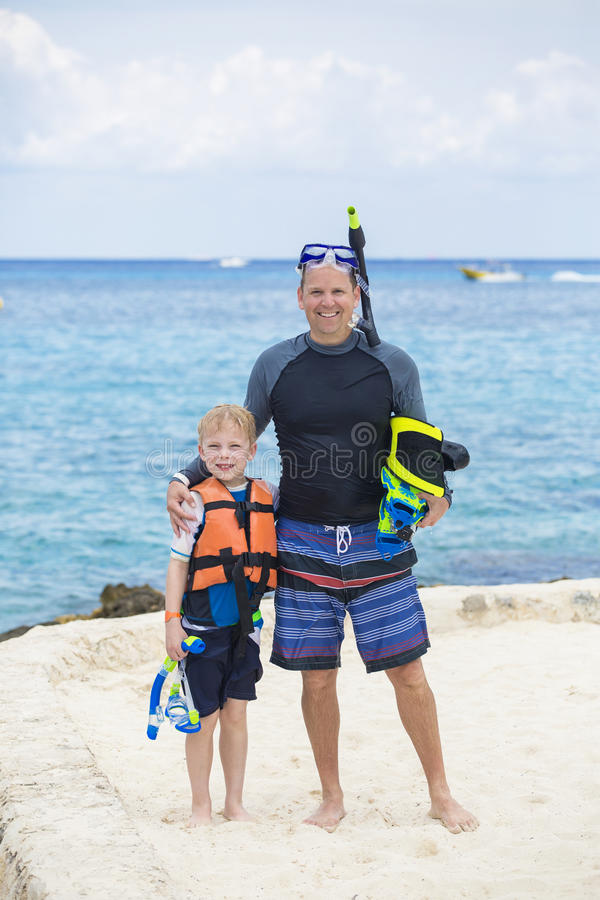 Young Family Snorkeling together in the Ocean stock image