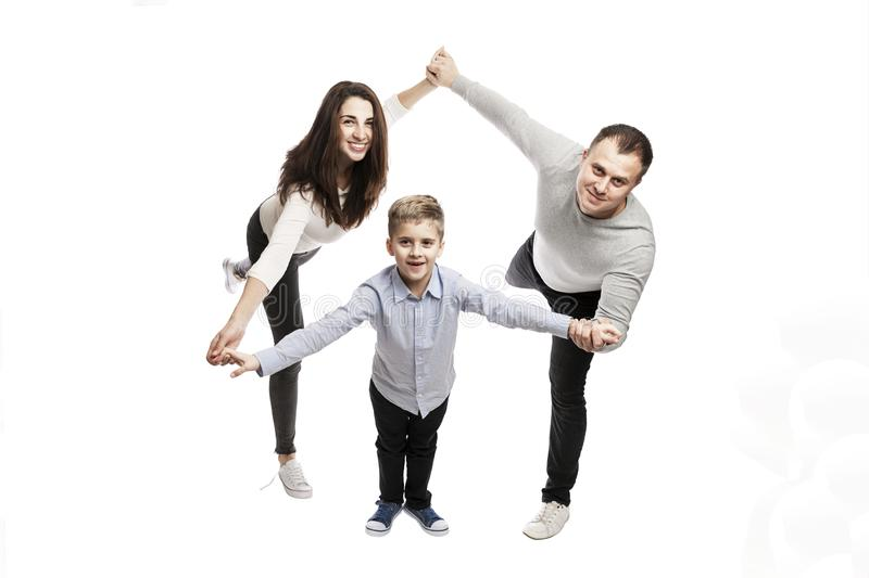 A young family with a son are holding hands and smiling. Love and happiness in the family. Isolated on a white background. stock photos