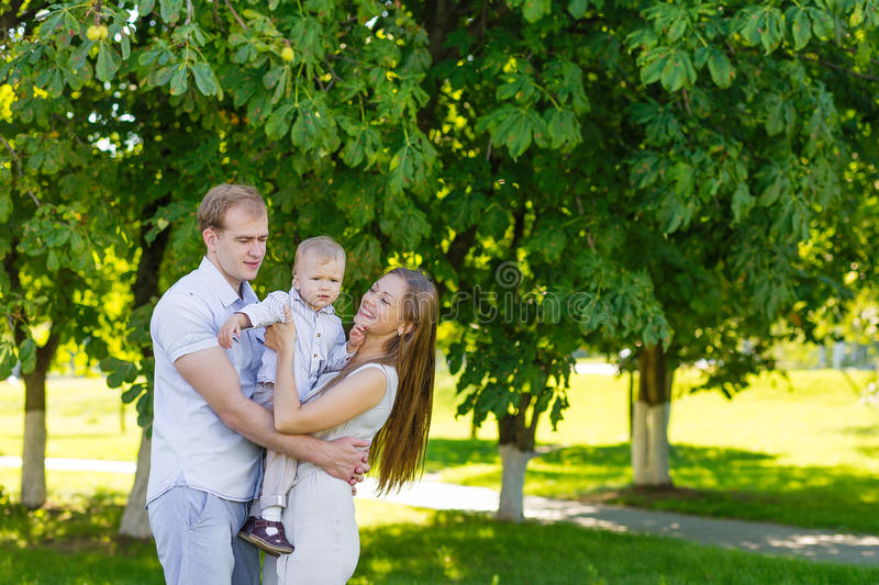 Young family with son in the park stock photo