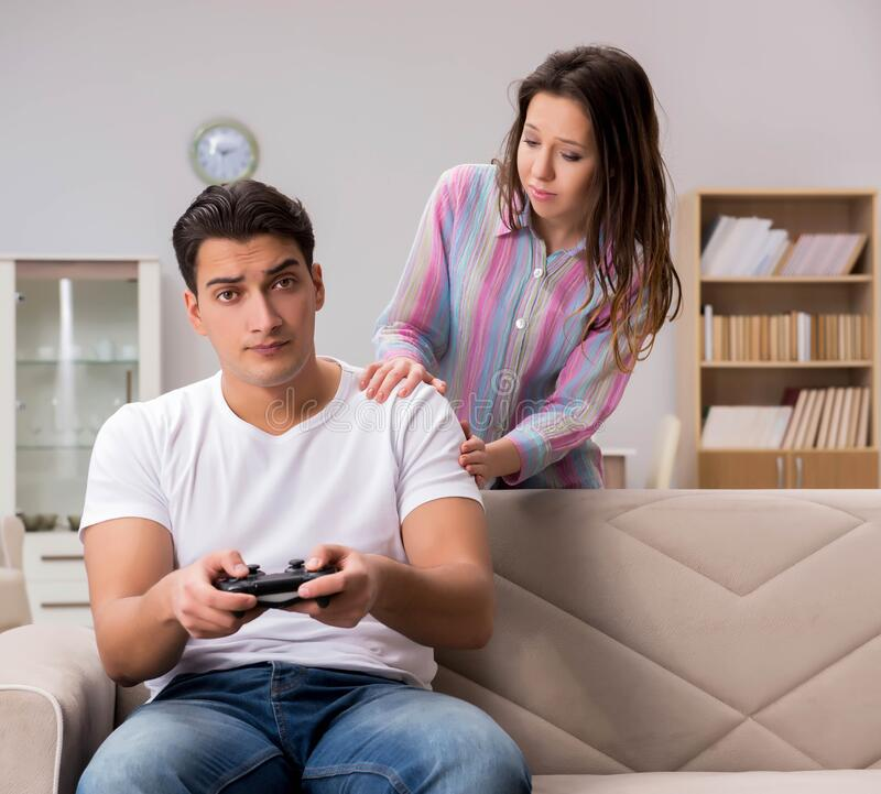 Young family suffering from computer games addiction royalty free stock photos