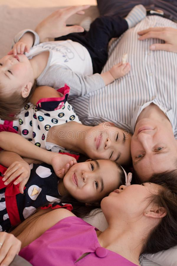 A young family with three young children. The concept of a happy big family. Hugs of loved ones royalty free stock photography