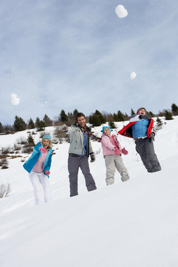 Young Family Throwing Snowballs On Winter Vacation stock image