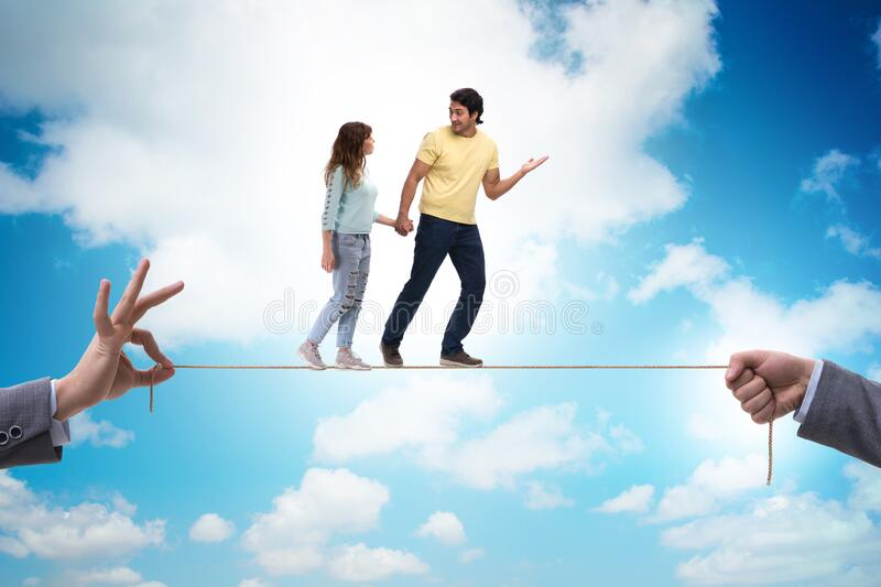 Young family on tight rope royalty free stock photo