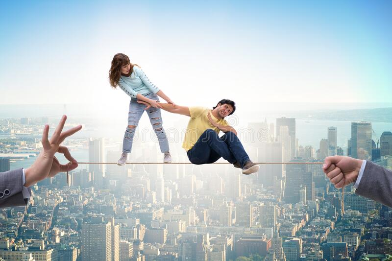 Young family on tight rope stock photos