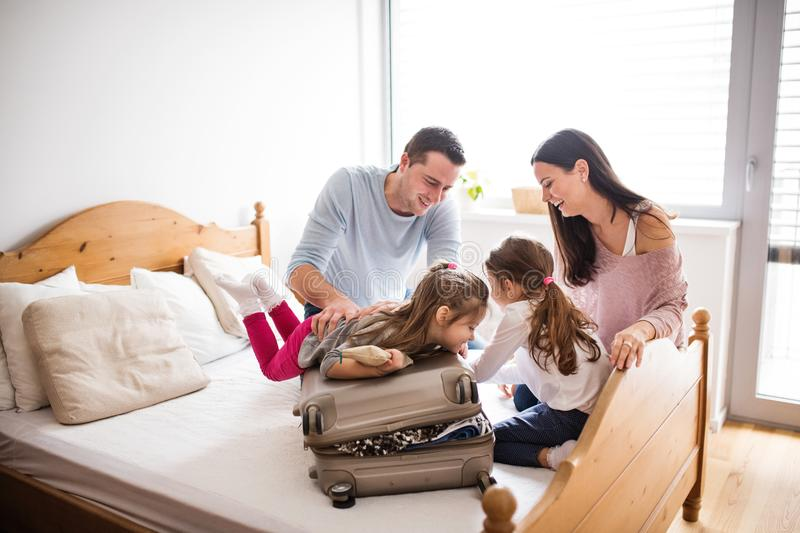 Young family with two children packing for holiday. royalty free stock photography
