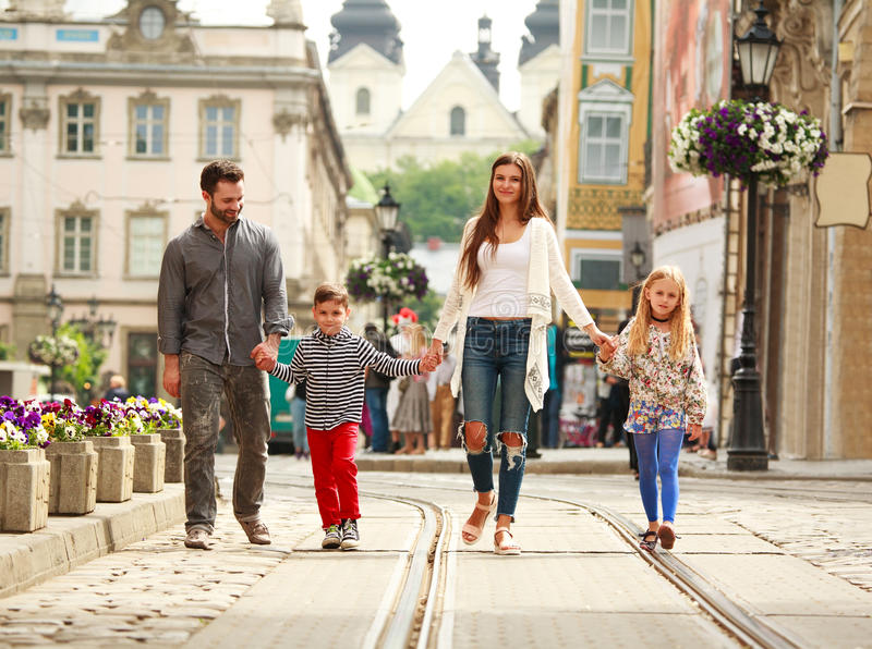 Young family with two kids walking street old tourist city royalty free stock photo