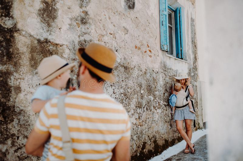 A young family with two toddler children in town on summer holiday. stock photos