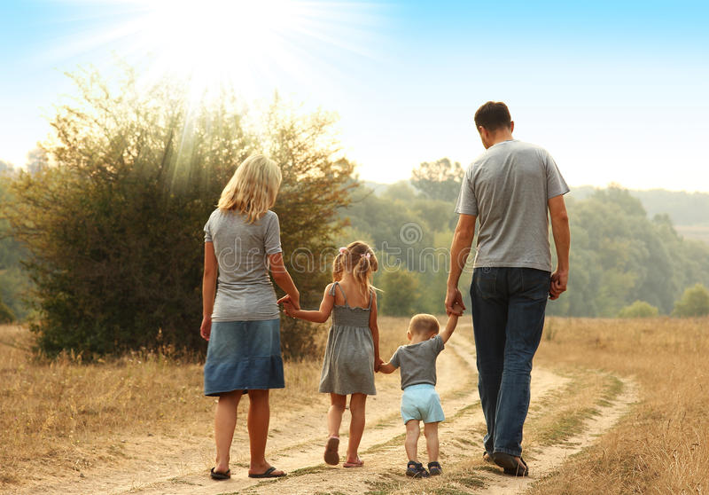 Young family walk together stock photos