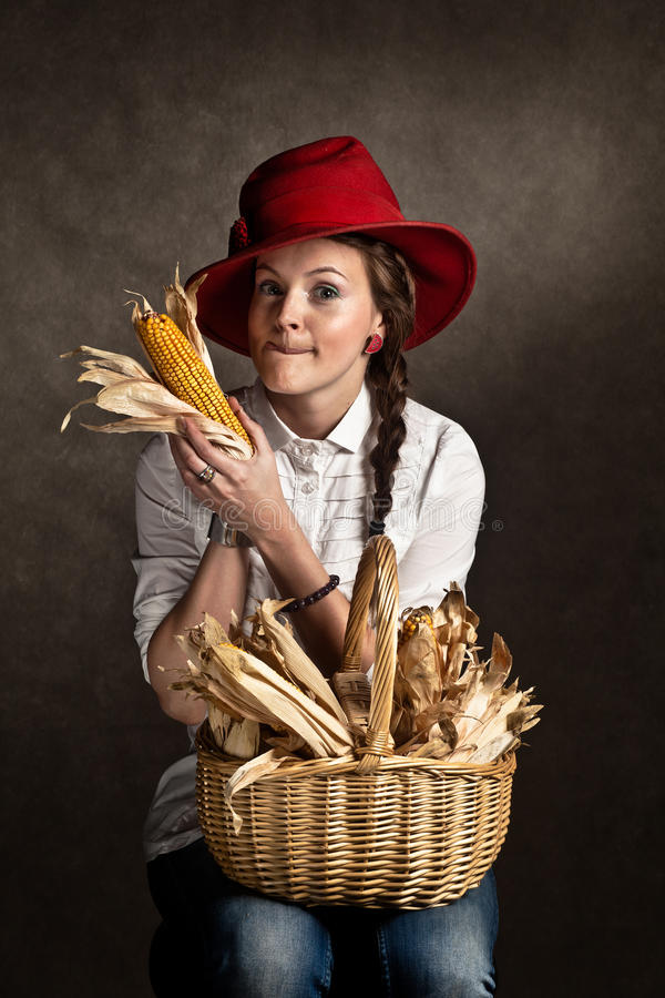Download Young Farmer Girl With A Corncob Stock Image - Image: 23123409