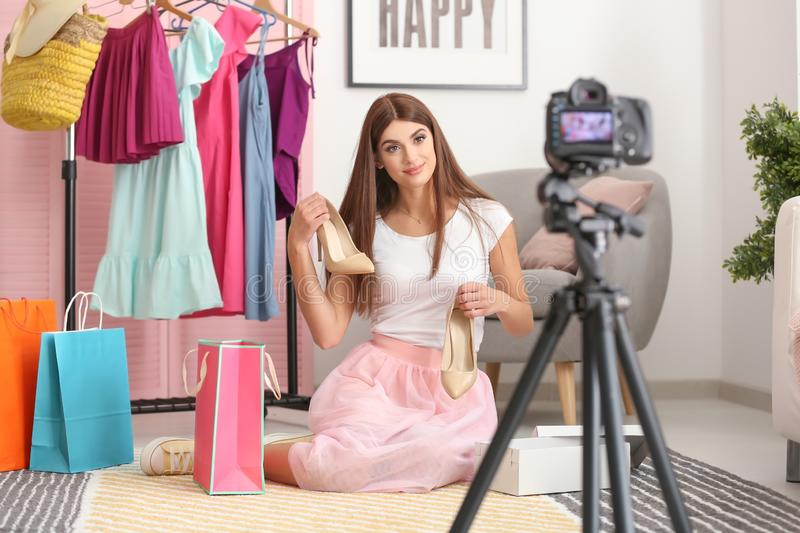 Young fashion blogger recording video at home royalty free stock photos