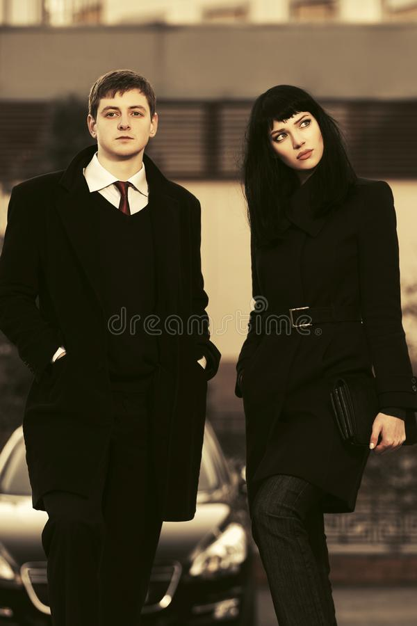 Young fashion business couple walking on city street stock photos