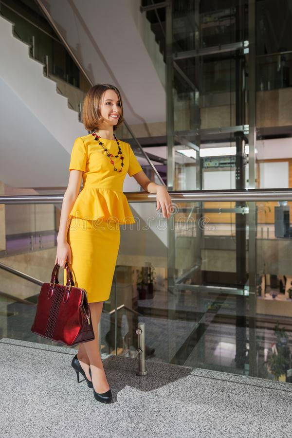 Free Young Fashion Business Woman In Yellow Peplum Dress With Handbag At Office Stock Images - 162692784