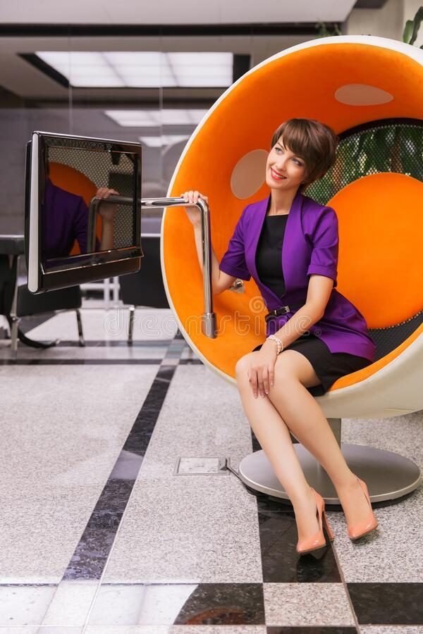 Free Young Fashion Business Woman Sitting On Computer Chair In Office Royalty Free Stock Image - 172949846