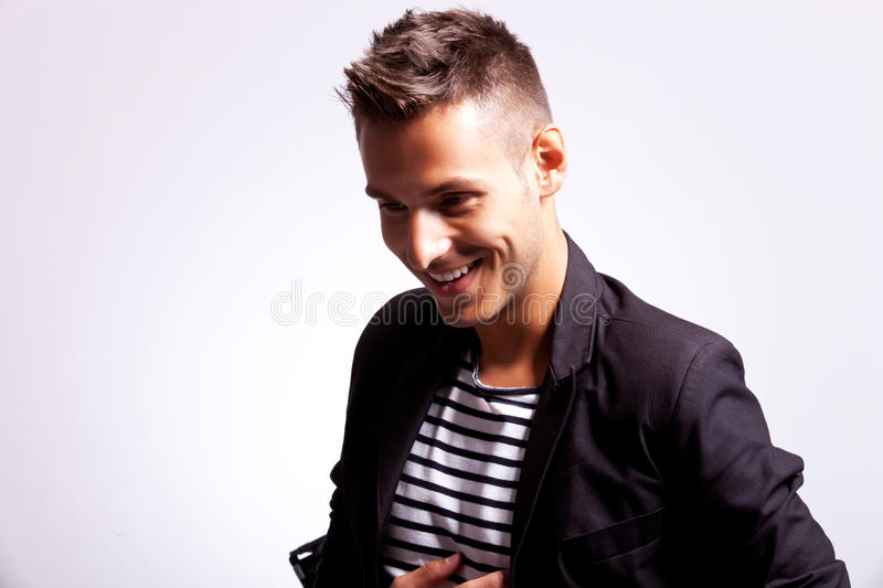 Young fashion casual man laughing royalty free stock images