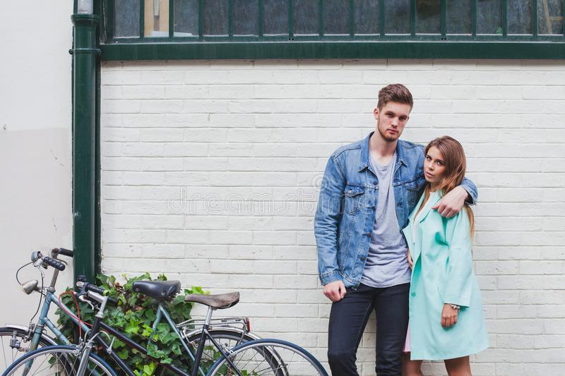 Young fashion caucasian couple looking at camera stock photography