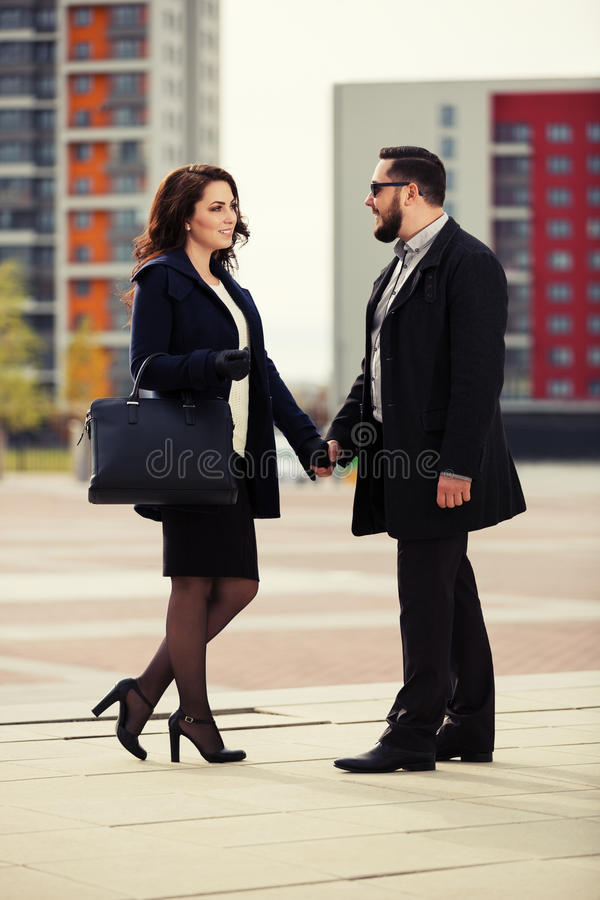 Young fashion couple in love walking on city street. Happy young fashion couple in love walking on city street stock photos