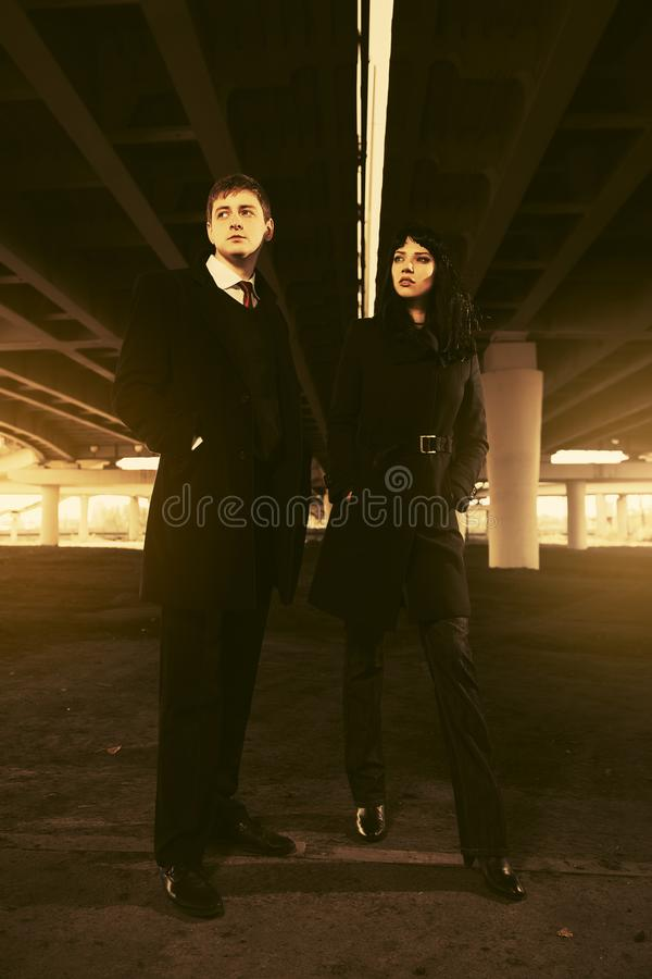 Young fashion couple under highway road intersection royalty free stock photos