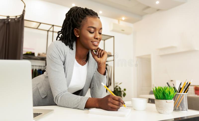Young Fashion Designer Drawing Sketches At Workplace royalty free stock photos