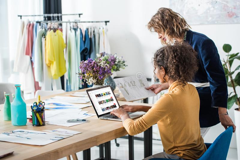 young fashion designers using laptop with multimedia website on screen stock photos